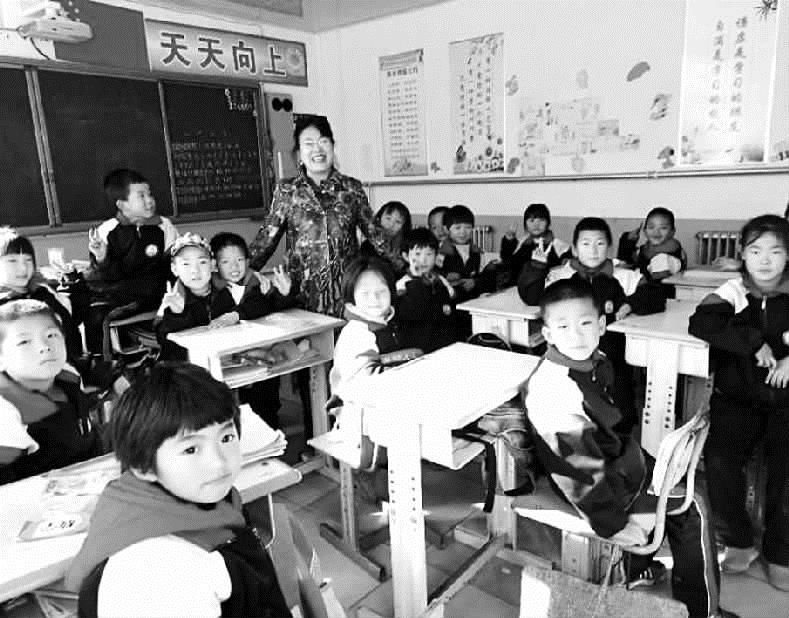 """""""北京老师""""田传真:课上扶智,课下扶贫"""