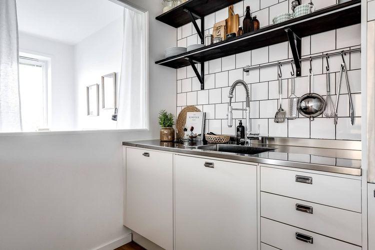 厨房橱柜台面是用大理石好,还是用石英石好?